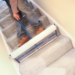 adjustable film applicator on stairs