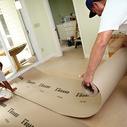 Lay Out X•Board for Durable Floor Protection